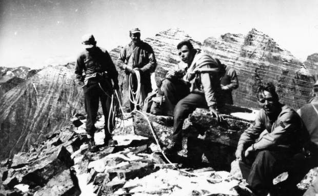 One b/w photograph of a group of Tenth Mountain Division soldiers after climbing a mountain near the Maroon Bells during World War II, early 1940s.
