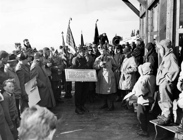One b/w photograph of the Tenth Mountain Division dedication at the opening of the Lift One (1947) at the Sundeck. Walter Paepcke is identified as the fourth adult from the left, with his hands in his coat pockets. Johnny Litchfield is holding a plaque that reads
