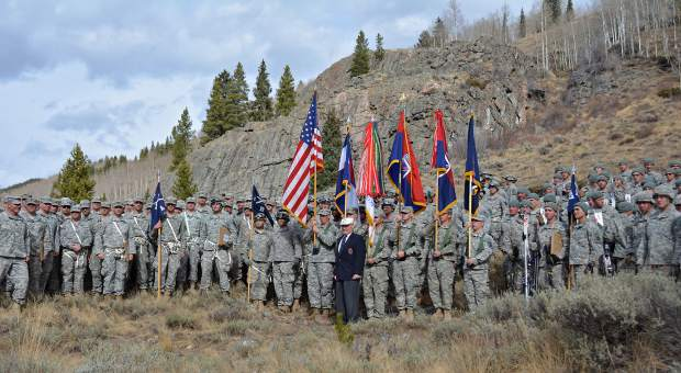 Army National Guard Staff Sgt. Lalita Laksbergs Hugh W. Evans, 10th Mountain Division World War II veteran and Silver Star recipient, stands with Soldiers of the 1st Battalion, 157th Infantry Regiment (Mountain), Colorado Army National Guard, after the re-patching ceremony Oct. 30, 2016, at Camp Hale, Colo. The ceremony recognized the 1-157 Infantry becoming part of the 10th Mountain Division (LI) and was held at Camp Hale to honor the 10th Mountain Division lineage and the historical significance to the unit to the state of Colorado.