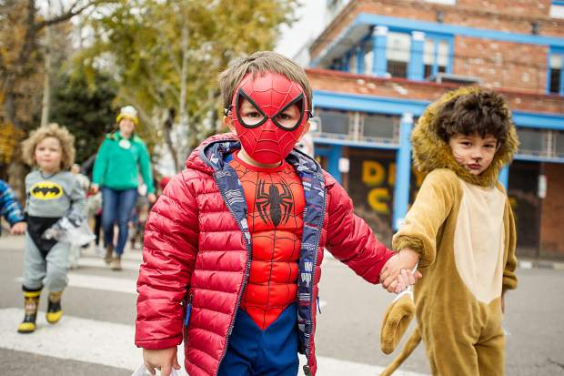 Kids from Aspen Mountain Tots daycare parade through town in costumes on Tuesday for Halloween