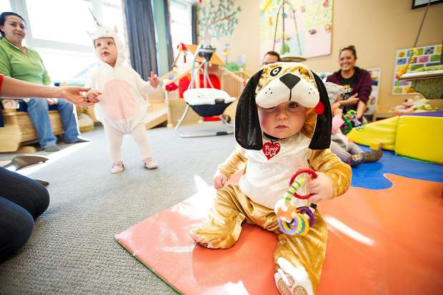 Briggs Myatt, 8 months, enjoys a party at the Yellowbrick daycare center on Tuesday for Halloween.
