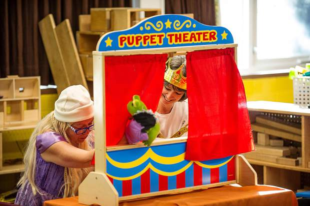 Suzanne Merrill, right, and Kathy Collins enact a puppet show Tuesday at the Yellowbrick daycare center for Halloween.