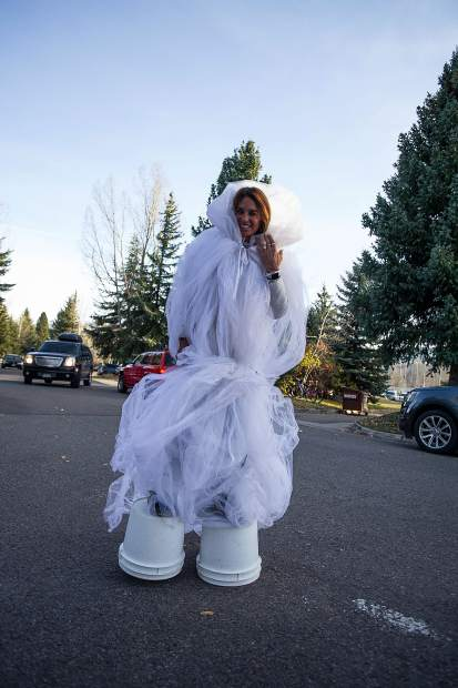 Kate McBride dressed as a ghost walks through the North 40 neighborhood on Tuesday trick or treating.