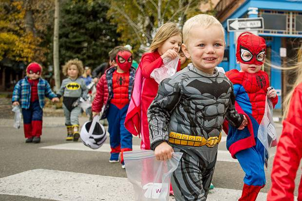William Gaumer, left, and Tyson Forbes from Aspen Mountain Tots daycare parade through town in costumes on Tuesday for Halloween.