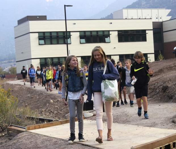 Mykel Backofen, left, and Cate Simpson, both seventh-graders, lead a pack of Glenwood Springs Middle School students on the