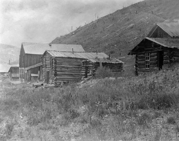 One b/w photograph of several old cabins at the ghost town of Independence, 1950-.