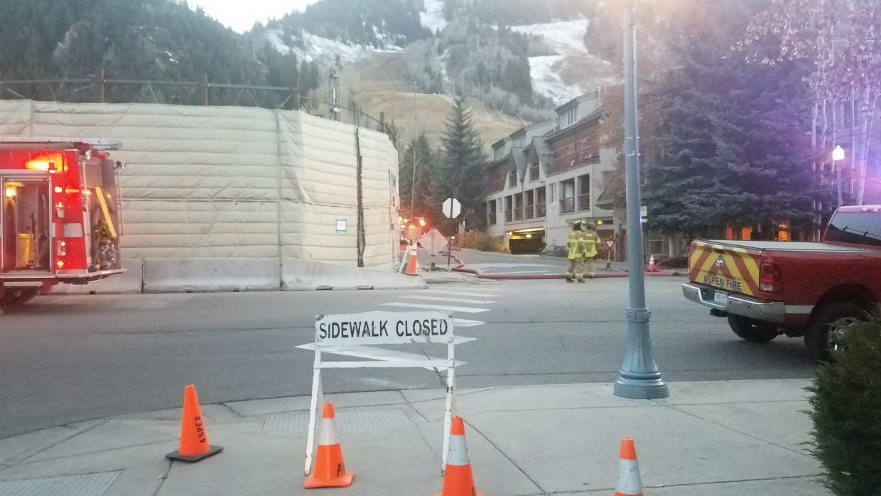 Aspen Fire crews work on a gas line that was cut Wednesday evening at the Sky Hotel construction site. A new W Hotel is going into the area.