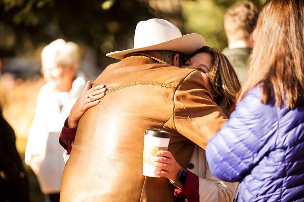 Tony Vagneur hugs Stefanie Stapleton Saturday morning before posing for a family photo outside of the Aspen Historical Society building.