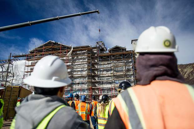 Construction workers watch as the last beam of the Snowmass Limelight is hoisted at the hotel's topping off party Nov. 1.