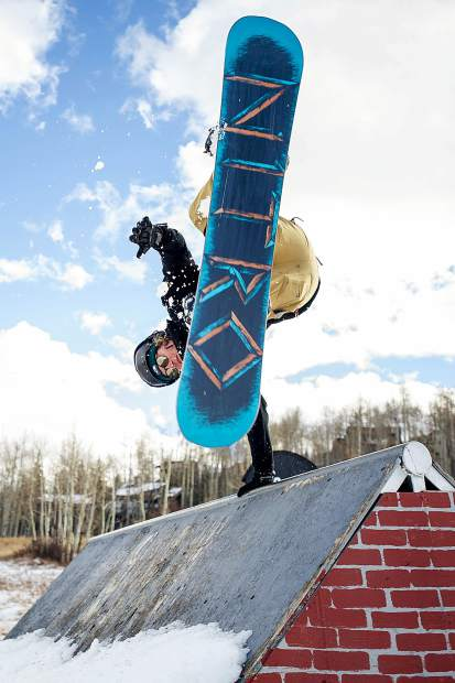 Mark Noonan does a handplant off of one of the features at the annual Thanksgiving Rail Jam in Snowmass on November 24, 2017.