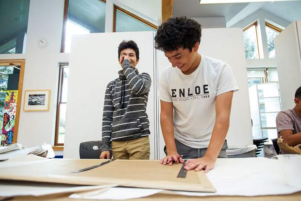 Ulysses, right, and Jaciel have a laugh while working on their Basalt Art Base mural on October 6.