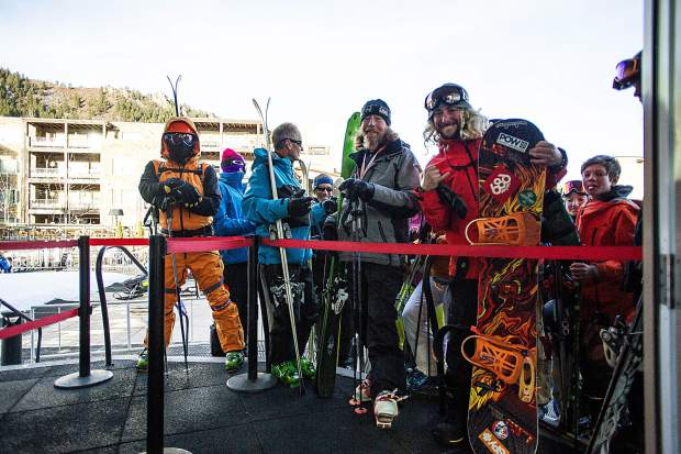 James Harvey, right, getting first chair on the Aspen Silver Queen Gondola for the start of the season on Aspen Mountain for opening day this Thursday.