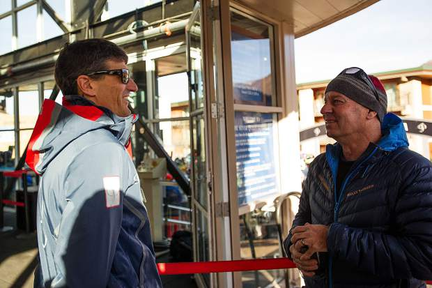 CEO of Aspen Skiing Company Mike Kaplan, left, and Director of Public Relations Jeff Hanle stand at the Silver Queen Gondola for opening day of Aspen Mountain on Thursday.