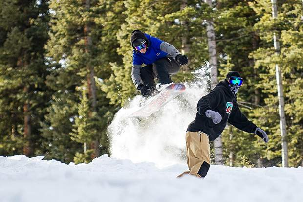 Joseph Bland and his brother Glenn David behind him send it on Aspen Mountain for opening day Thursday.