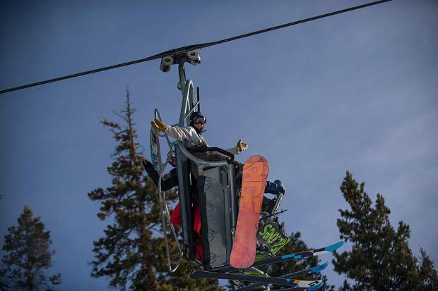 Riders going up the Ajax Express on Aspen Mountain on Thursday for opening day.