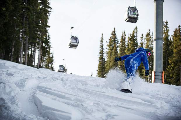 A snowboarder makes his way down Aspen Mountain on opening day on Thursday.