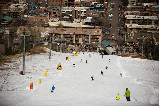 Skiers and snowboarders finish their top to bottom runs on the Little Nell run on Aspen Mountain for opening day Thursday.