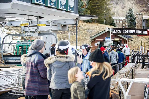 The line for the Skittles gondola at Snowmass for their opening day Thursday.