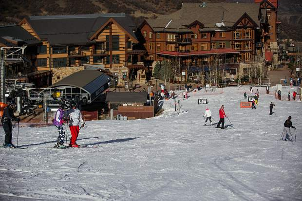Skiers and snowboarders make their way down Fanny Hill Thursday afternoon of Snowmass Mountain's opening day.
