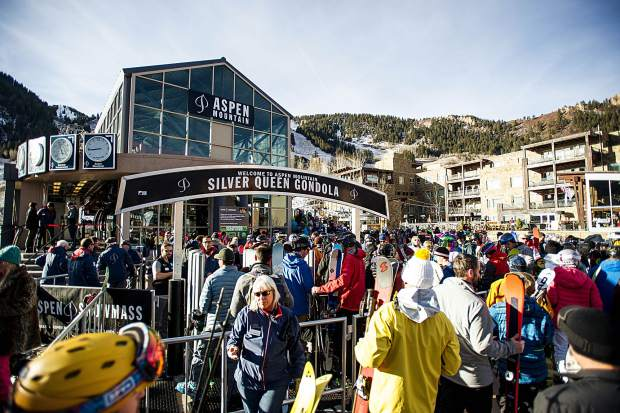 Crowds gathered at the base of the Silver Queen Gondola on Aspen Mountain for opening day on Thursday.
