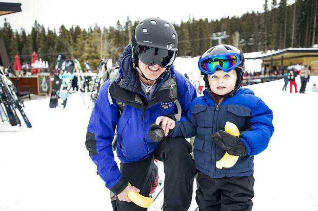 Kieran Keleher, 2, and his Dad Chris pose for a photo with bananas that he found on Snowmass Mountain on Saturday for the Banana Days scavenger hunt.