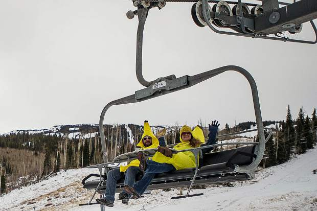 People ride down the Village Express lift dressed as bananas for Banana Days in Snowmass on Saturday.