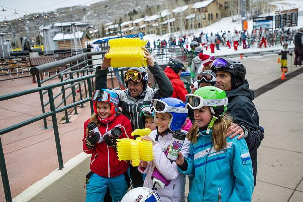 A group poses for a photo at the end of the mall in Snowmass Village on Saturday with their bananas they found for the Banana Days scavenger hunt for the 50th anniversary celebrations.