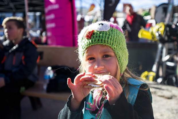 McKinlee Trumble, 4, from Grand Junction enjoys a s'more in Base Village at Snowmass on Friday for the 50th anniversary celebrations.