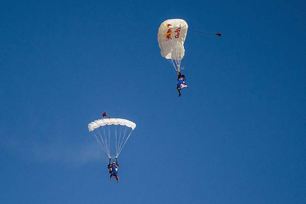 Red Bull air force team fly through the air to land on Fanny Hill in Snowmass on Friday for the 50th anniversary.