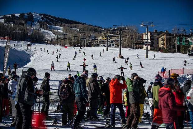 Ski patrollers wave their arms on Fanny Hill to slow people down on Snowmass for the 50th anniversary celebrations on Friday.