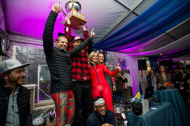 Jonas Nyberg holds up the Gorsuch Cup that hisTeam Super G won at the Aspen Valley Ski and Snowboard Club annual Ajax Cup fundraiser held at Shlomo's on Saturday after the racing. Nyberg was the pro for his team and also coaches at AVSC.
