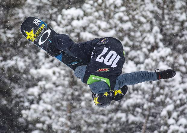 Jake Pates of United States competes in the snowboard superpipe qualifiers during the Dew Tour event Thursday, Dec. 14, at Breckenridge Ski Resort.