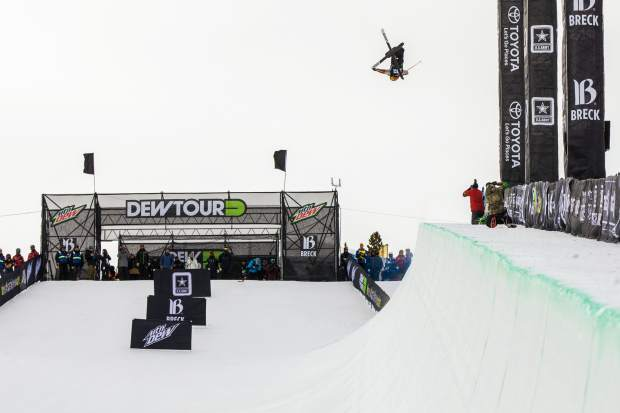 Alex Ferreira of the United States rotates high above the Dew Tour superpipe during Wednesday's men's ski halfpipe qualifier. Ferreira tallied an 89.66 to qualify in second place for Friday's final.