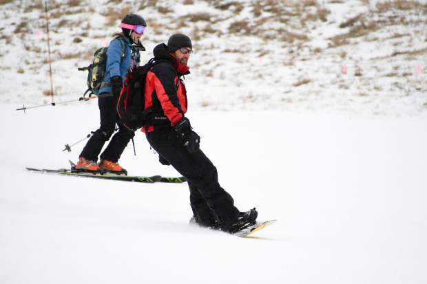 Snowboarders and skiers make their way down the slope during opening day at Sunlight Mountain Resort on Thursday.