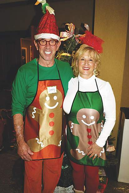 Jim and Helen Fifield deck the halls for the Buddy Program's holiday event.