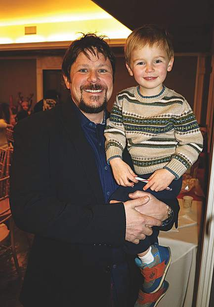 Ken Adler with KA Designworks, an event sponsor of the Gingerbread House Workshop, with his son Evan.