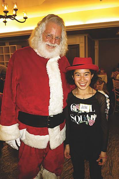 Santa Claus with a stylish little Buddy named Jackie.