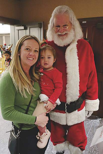 Susan and Sydney Chen with St. Nick.