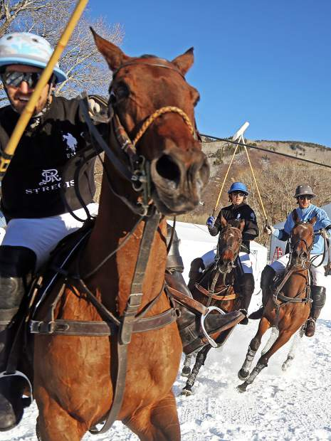 St. Regis, in black, plays Aspen Valley Polo Club in the consolation game of the World Snow Polo Championship on Sunday in Aspen.
