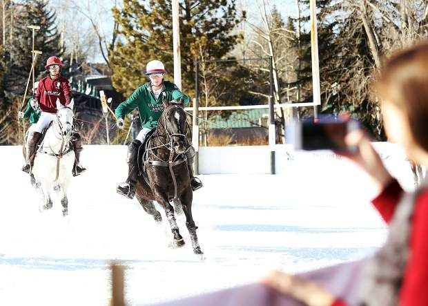 Jauncito Bollini of U.S. Polo Assn. goes on the offensive against Flexjet in the World Snow Polo Championship final on Sunday at Rio Grande Park in Aspen. U.S. Polo Assn. won, 5-4.