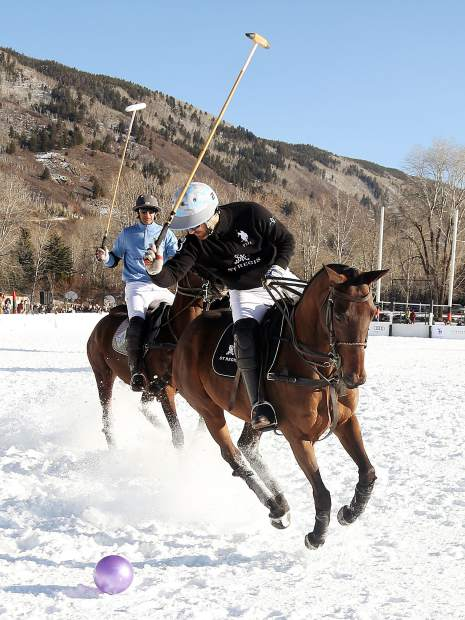 St. Regis player Nico Pieres chases down the ball against Aspen Valley Polo Club in Sunday's consolation match of the World Snow Polo Championship in Aspen.