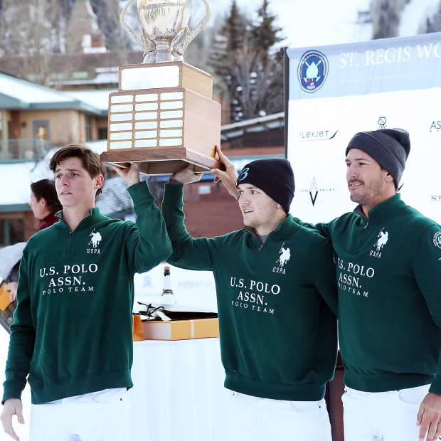 From left, Juancito Bollini, Grant Ganzi and Nic Roldan celebrate with the trophy after winning the 2017 World Snow Polo Championship on Sunday at Rio Grande Park in Aspen.