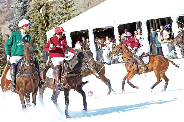 Flexjet, in red, faces U.S. Polo Assn. in the finals of the 2017 World Snow Polo Championship on Sunday at Rio Grande Park in Aspen. U.S. Polo Assn. won, 5-4.