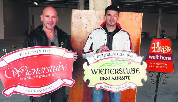 Nemanja Ilic, left, and Vladan Djordjevic, will reopen the Wienerstube Restaurant at Willits Town Center in Basalt. They are displaying original signs from the former Aspen restaurant, which closed January 2011.