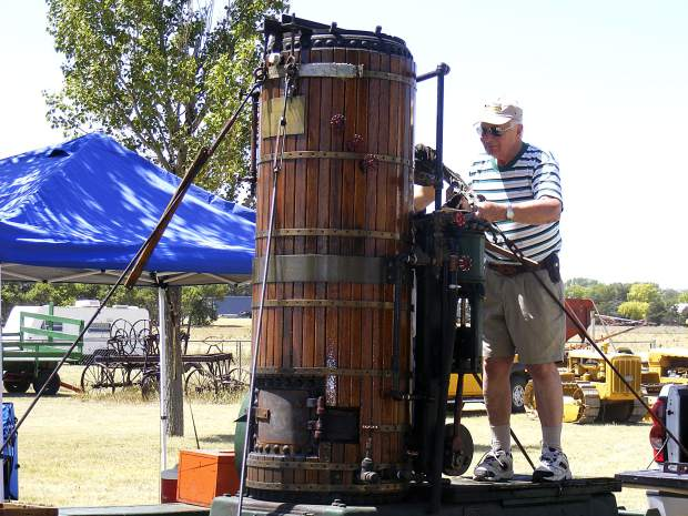 Carl Bergman, Aspen gets ready to set up his 1878 boiler to power a 10-note calliope during the 2012 Tri-State Antique Thresher Show in Bird City, Kansas.