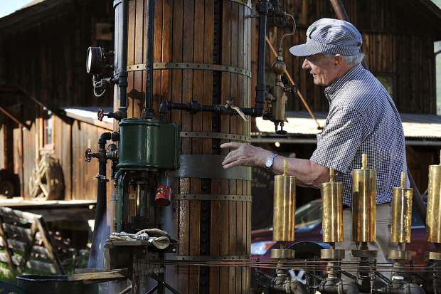 Carl Bergman plays his steam calliope during an event at the Marolt Barn in 2009. The longtime owner of Carl's Pharmacy died this week at his home in Aspen. He waas 85.
