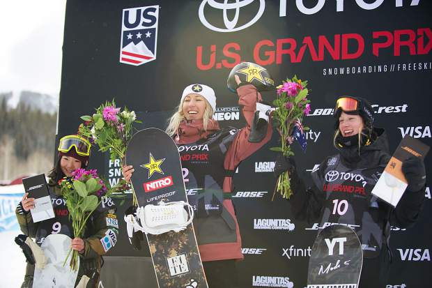 New Zealand's Christy Prior is all smiles on the podium after winning the women's snowboard slopestyle finals at the U.S. Grand Prix in Snowmass on Friday. Prior won with an overall score of 77.06, Reira Iwabuchi of Japan took second, and Tess Coady of Australia took third.