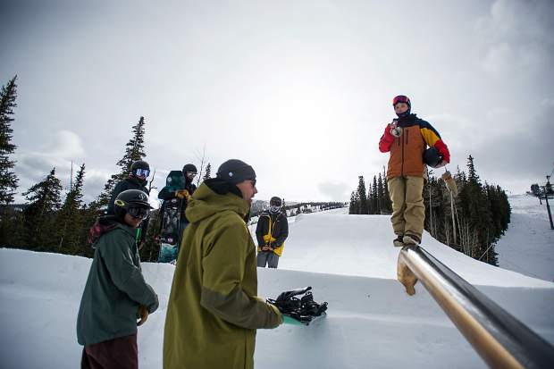Robert Pettit, a competitor in the upcoming U.S. Grand Prix event tells the Snowmass terrain park crew suggestions for the first rail feature after testing it on Saturday.