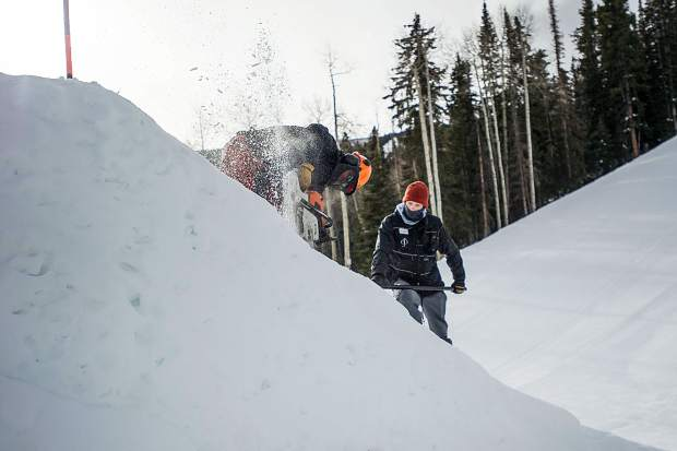 Chris Branstetter chainsaws the side of the first jump for the slopestyle course on Saturday for the U.S. Grand Prix competition this week in Snowmass. The terrain park crew works precisely to create clean looking jumps.
