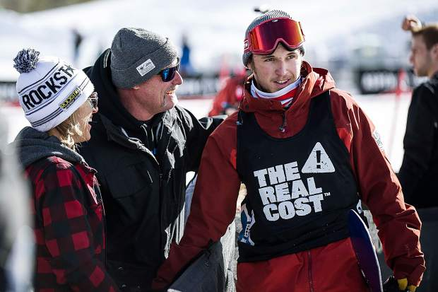 Brook and Laura Corning congratulate their son Chris after he stomped his first run with a score of 84.00 at the men's snowboard slopestyle qualifiers at X Games in Aspen on Thursday. Corning, of Silverthorne in Summit County, took third overall during qualifiers to qualify for Saturday's final.
